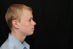 Ernstes Jugendlichprofil Stockfoto