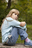 Ernstes kleines Mädchen neun Jahre alt Lizenzfreie Stockbilder