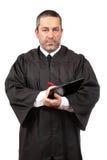 Ernstes männliches Richterschreiben lizenzfreie stockbilder