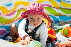Ernstig kind met speelgoed Royalty-vrije Stock Foto
