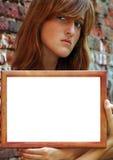 Ernstig meisje met frame Royalty-vrije Stock Foto's