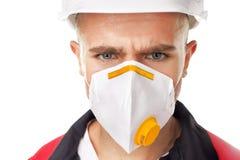 Ernstige arbeider die ademhalingsapparaat dragen Royalty-vrije Stock Foto's