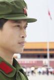 Ernstige Chinese Communistische Solider die een Hoed dragen stock afbeeldingen