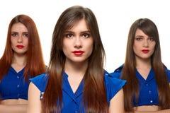 Ernstige drietallenmeisjes Stock Afbeeldingen