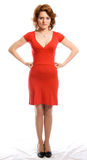 Ernstige jonge vrouw in rode kleding stock afbeelding
