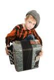 Ernstige jongen met harmonika Stock Fotografie