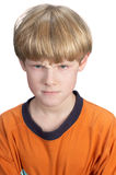 Ernstige jongen op wit Royalty-vrije Stock Foto's