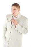 Ernstige mens in een wit kostuum met glazen Royalty-vrije Stock Foto