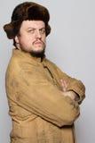Ernstige mens in hoed. Oude de winterkleding. Royalty-vrije Stock Afbeeldingen