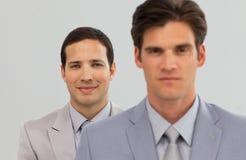 Ernstige Partners die zich in een lijn bevinden Royalty-vrije Stock Foto's