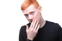 Ernstige redhead jongen stock foto