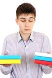 Ernstige Student met de Boeken Royalty-vrije Stock Afbeeldingen