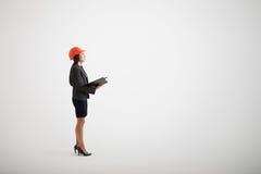 Ernstige vrouw die in formele slijtage omhoog kijken Stock Afbeeldingen