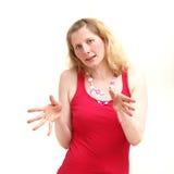Ernstige vrouw die met haar handen verklaart Stock Afbeeldingen