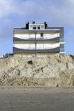 Eroded beach and constructions Royalty Free Stock Photo
