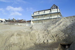 Eroded beach and constructions Stock Photos