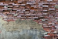 Eroded brick wall. With partial cement patch royalty free stock images