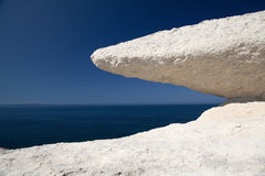 Eroded chalk rock white stone blue sky and sea Stock Photos
