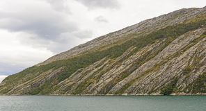 Eroded Granite Hills along a Fjord Stock Image