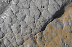 Eroded grey rock texture with some sand Stock Photos