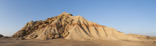 Eroded hill. Eroded mountain hill panorama at Bardenas Reales with blue sky Royalty Free Stock Photo