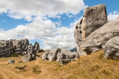 Eroded limestone boulders at Castle Hill, New Zealand. With sky and copy space royalty free stock images