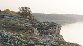 Eroded limestone cliff with limestone coastline in the background stock footage