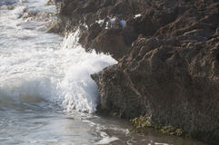 Eroded limestone rock and wave. La Zenia, Costa Blanca, Spain Stock Photos