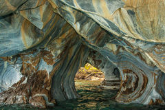 Eroded Marble Cavern. Cavern Eroded Into Marble Peninsula Along Shoreline of Lake General Carrera royalty free stock photography