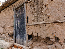 Eroded Mud Shed Wall Stock Image