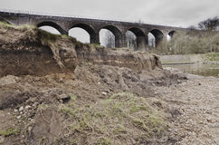 Eroded riverbank after winter flood, Reddish Vale Manchester Eng Stock Images