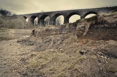 Eroded riverbank after winter flood, Reddish Vale Manchester Eng Stock Photo