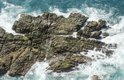 Eroded rock in ocean Royalty Free Stock Images