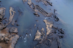 Eroded rock in a river bed Royalty Free Stock Photo