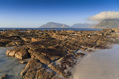 Eroded rocks on the beach - landscape. Near Cape Town Stock Images
