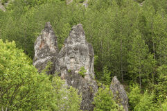 Eroded rocks in mountains Stock Images