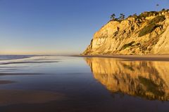 Eroded Sandstone Cliffs Reflected on Torrey Pines State Beach La Jolla San Diego California. Eroded Sandstone California Cliffs and Torrey Pines State Beach royalty free stock photo
