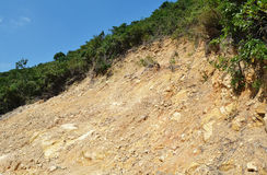 Eroded slope. Soil erosion on the side of a hiking path in Hong Kong after heavy rainfall Royalty Free Stock Photos