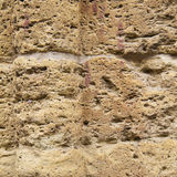 Eroded stone wall background Stock Photo