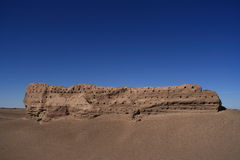 Eroded Stone Wall in Desert Stock Photography