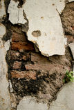 Eroded Textured Vintage Colonial Wall  in Asia with Brick and St. Eroded Textured Stucco Vintage Colonial Wall  in Asia with multiple Materials and Layers. Old Royalty Free Stock Image