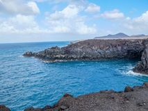 Eroded volcanic sea caves and cliffs at Los Hervideros in Lanza Royalty Free Stock Photos