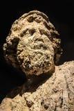 Eroderade egentligen huvudet av Poseidon - guden av havsjordskalvstormarna och hästar - som var undervattens- på länge och göras  royaltyfri foto