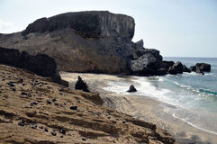Eroding beachfront islet cliff Stock Images
