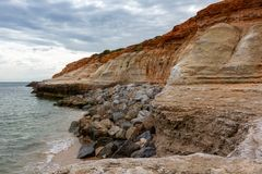 The eroding cliffs at Port Noarlunga and the protective rocks pl. Aced as a prevention method in South Australia on 23rd August 2018 royalty free stock photo