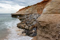 The eroding cliffs at Port Noarlunga and the protective rocks pl. Aced as a prevention method in South Australia on 23rd August 2018 royalty free stock images