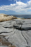 Eroding granite coastline Stock Photos