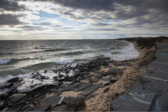 Erosão de praia fotografia de stock royalty free