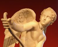 Eros. Marble Romean statue of the Greek god Eros Stock Image