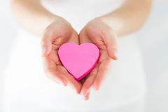 Eros - Hands Offering a heart Royalty Free Stock Images